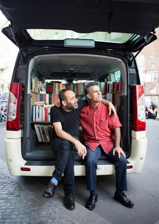 Hiwa K and Bakir Aki in front of the taxi-library