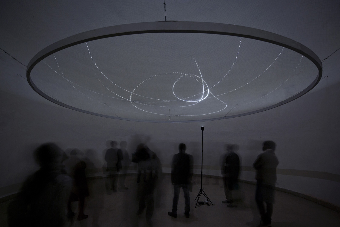 In the Faraway Past and in the Future, 2014. Aluminium construction, LED lights, control units, monofilament. Diameter 600 cm.